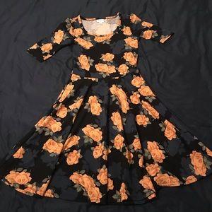 LulaRoe Nicole dress with yellow rose pattern